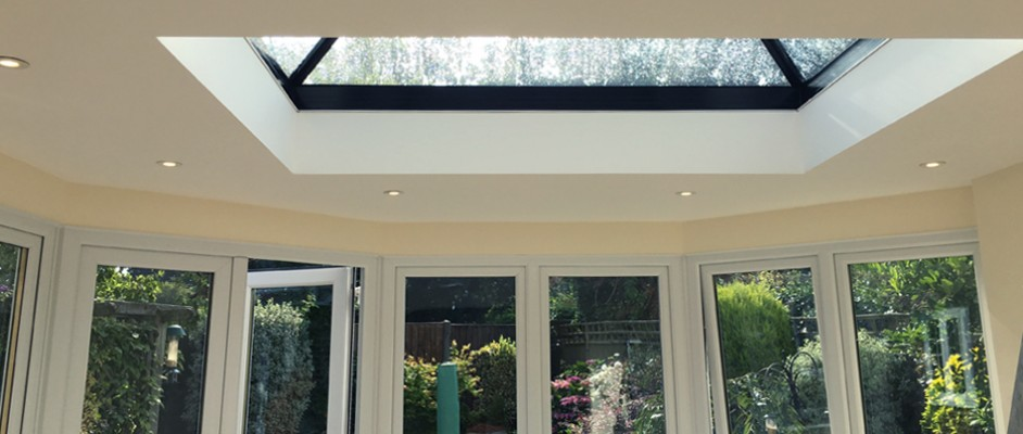 Uplands, new fibreglass flat roof with a slimline glass skylight.